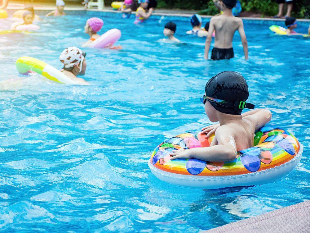 Children swimming in public pool