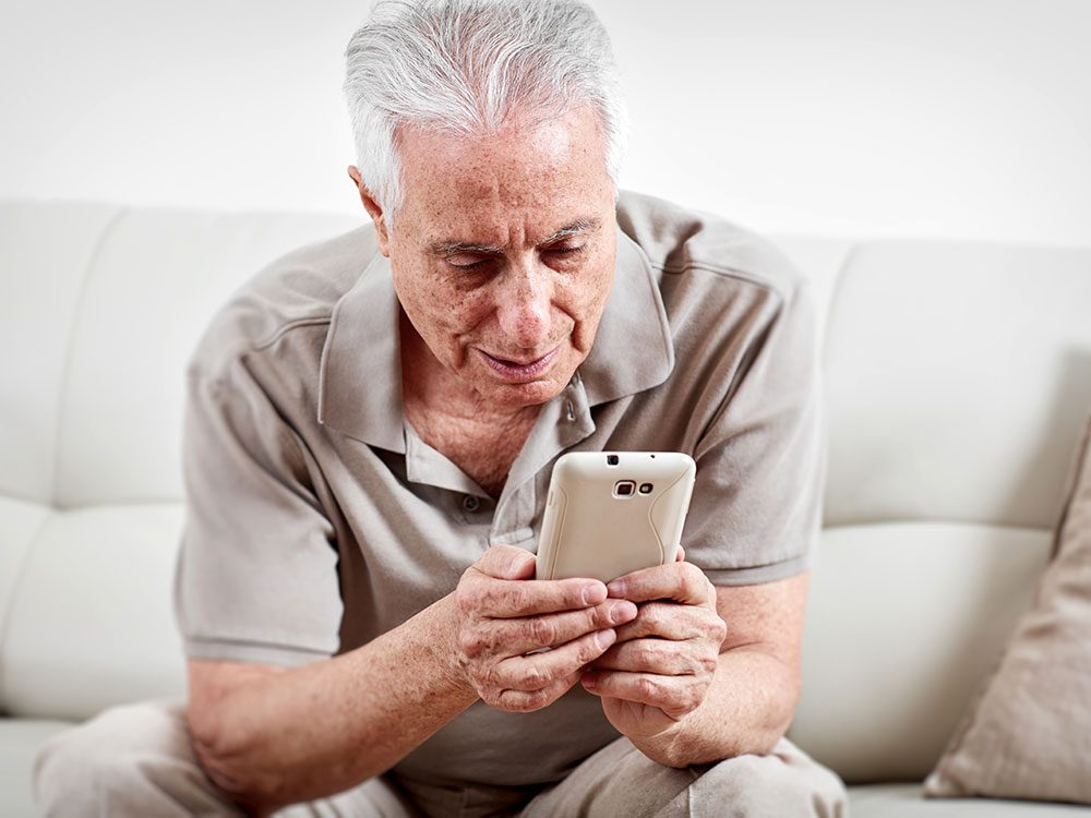 Senior getting a medication reminder via smartphone