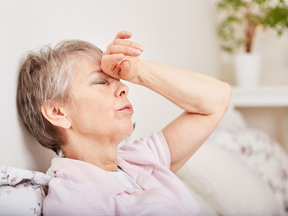 Woman dizzy from orthostatic hypotension