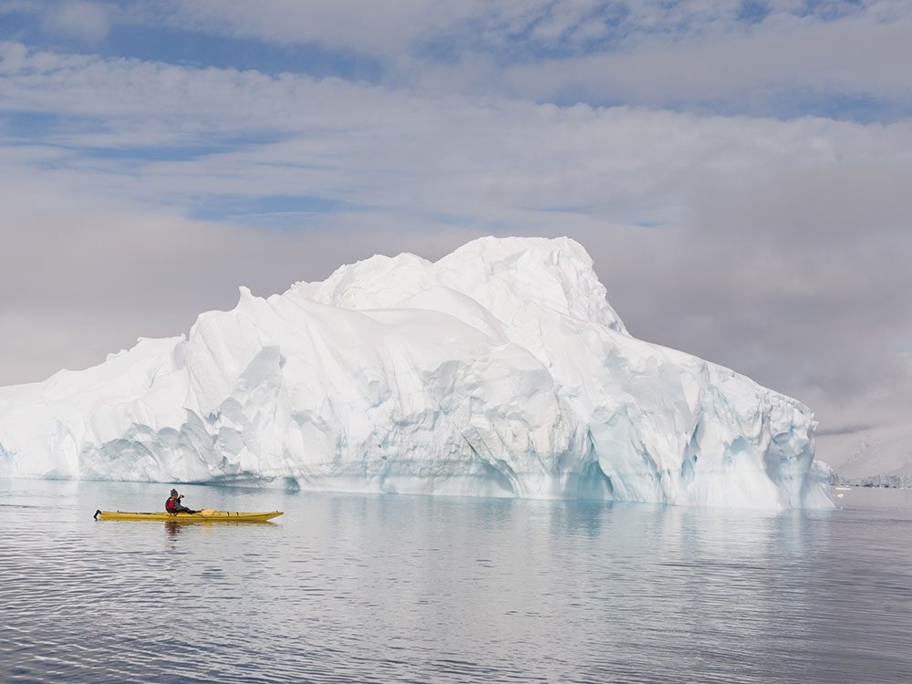 Living in Canada - kayak with iceberg
