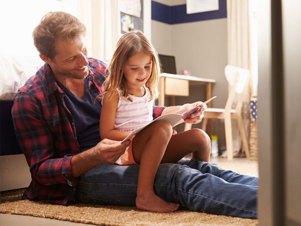 Father reading story for his daughter
