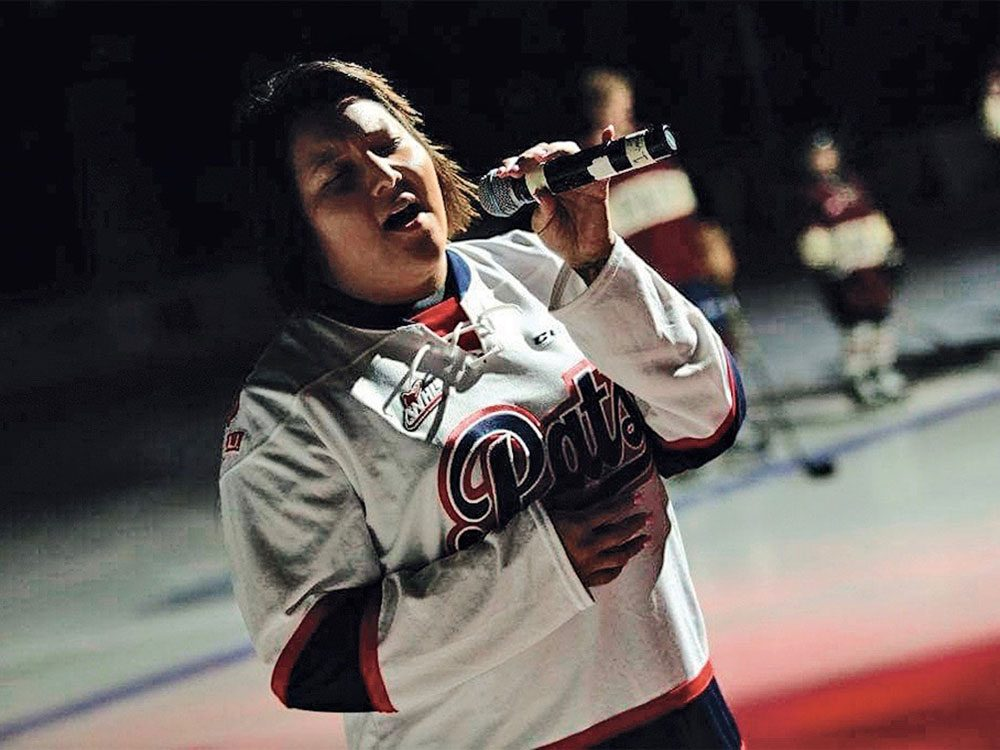 Teagan Littlechief performing at CFL game