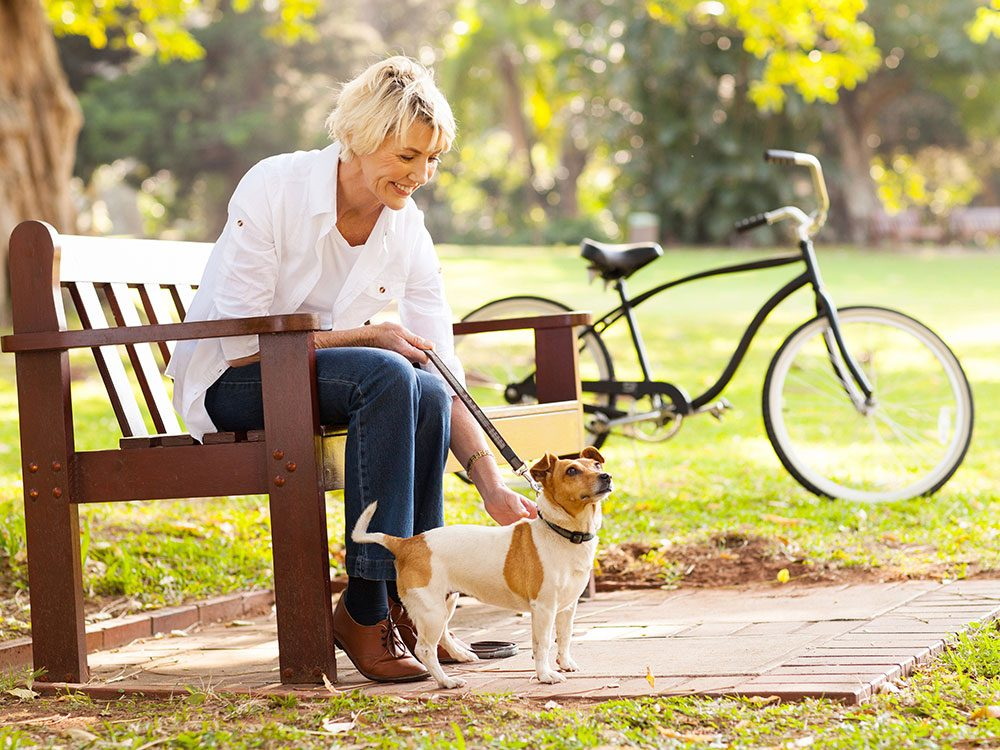 Middle-aged woman with her small dog