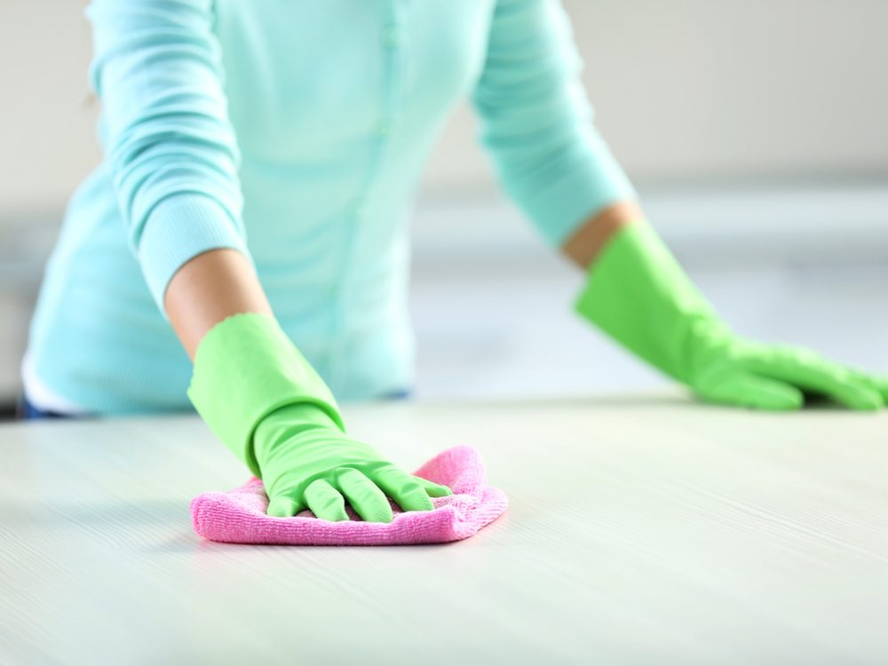 Woman scrubbing kitchen counter