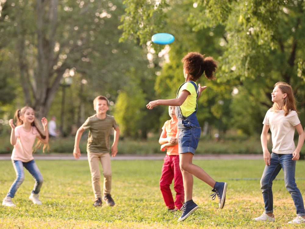 Group of children playing with frisbee