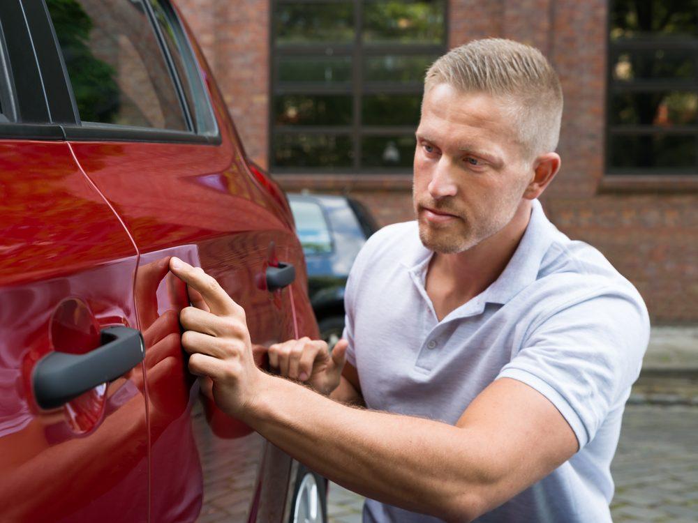 Man applying wax to his car