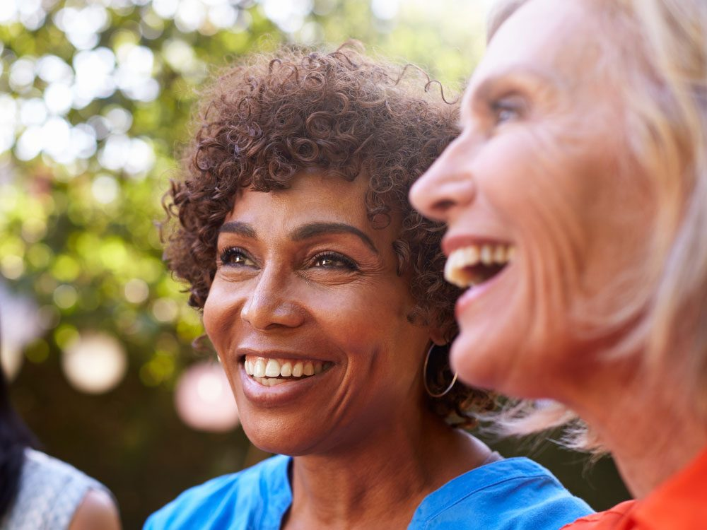 Two senior women laughing