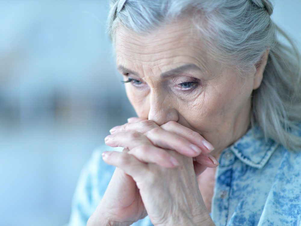 Close-up of sad elderly woman