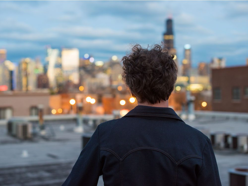 Thirtysomething man contemplating his future while looking at cityscape