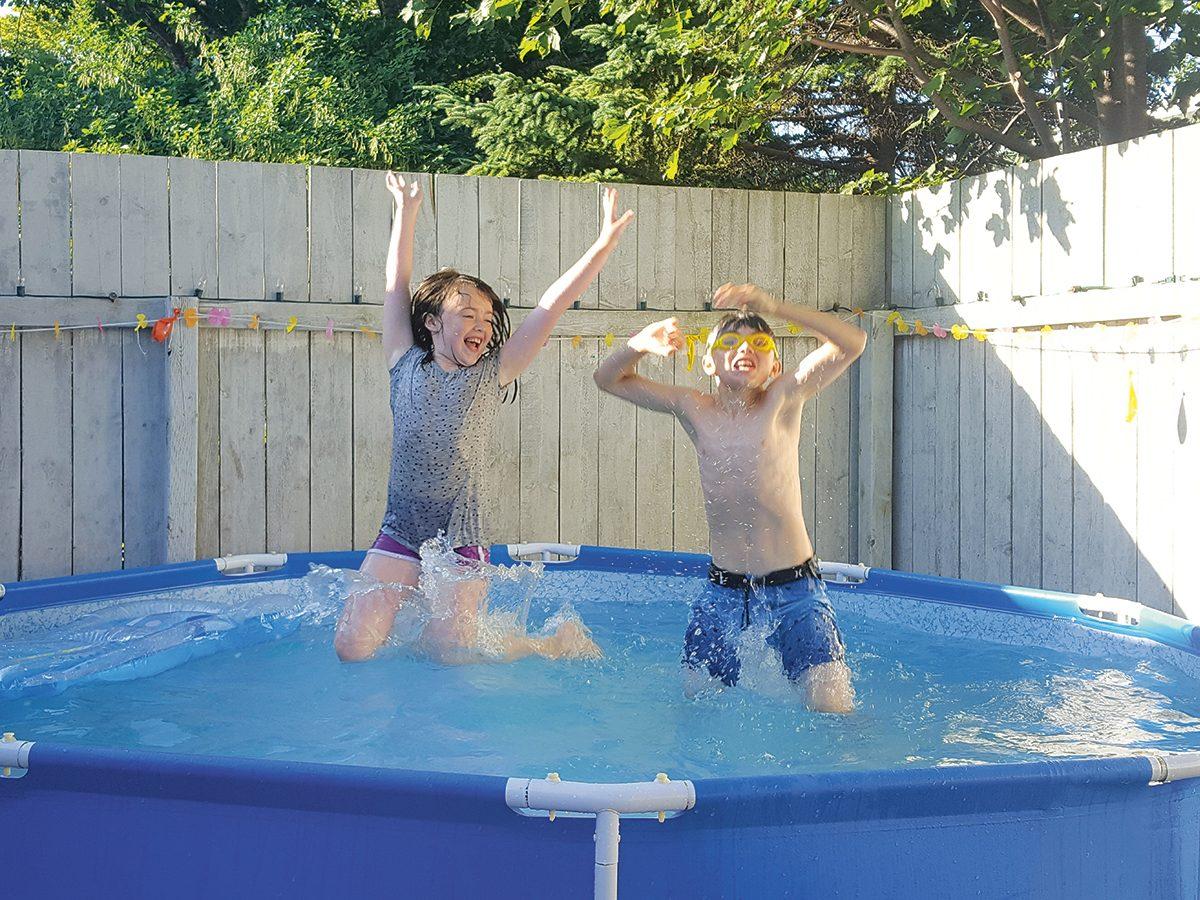 Making a splash water photography - kids in backyard pool
