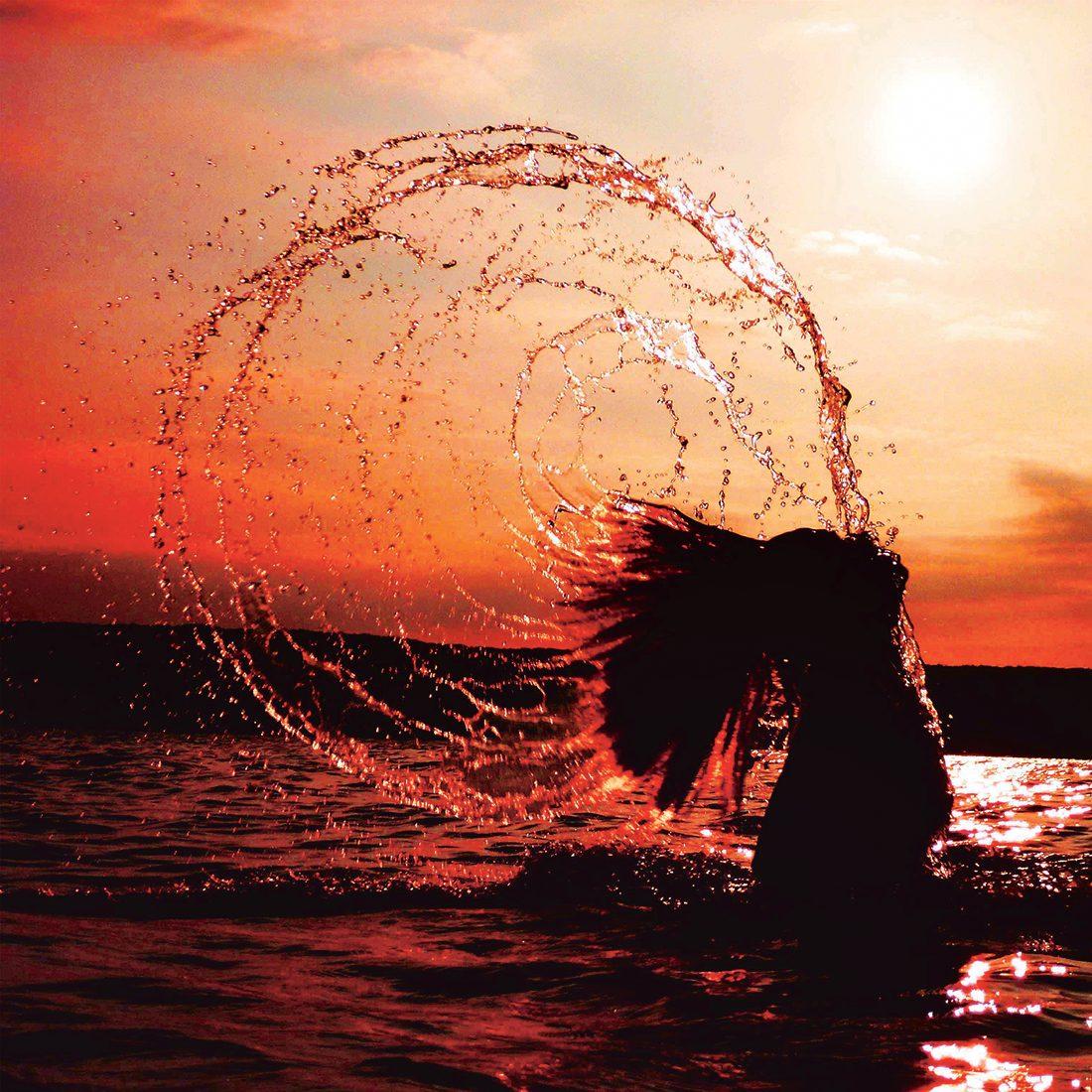 Making a splash water photography - sunset