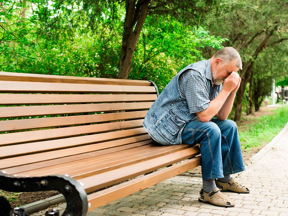 Depressed man on park bench