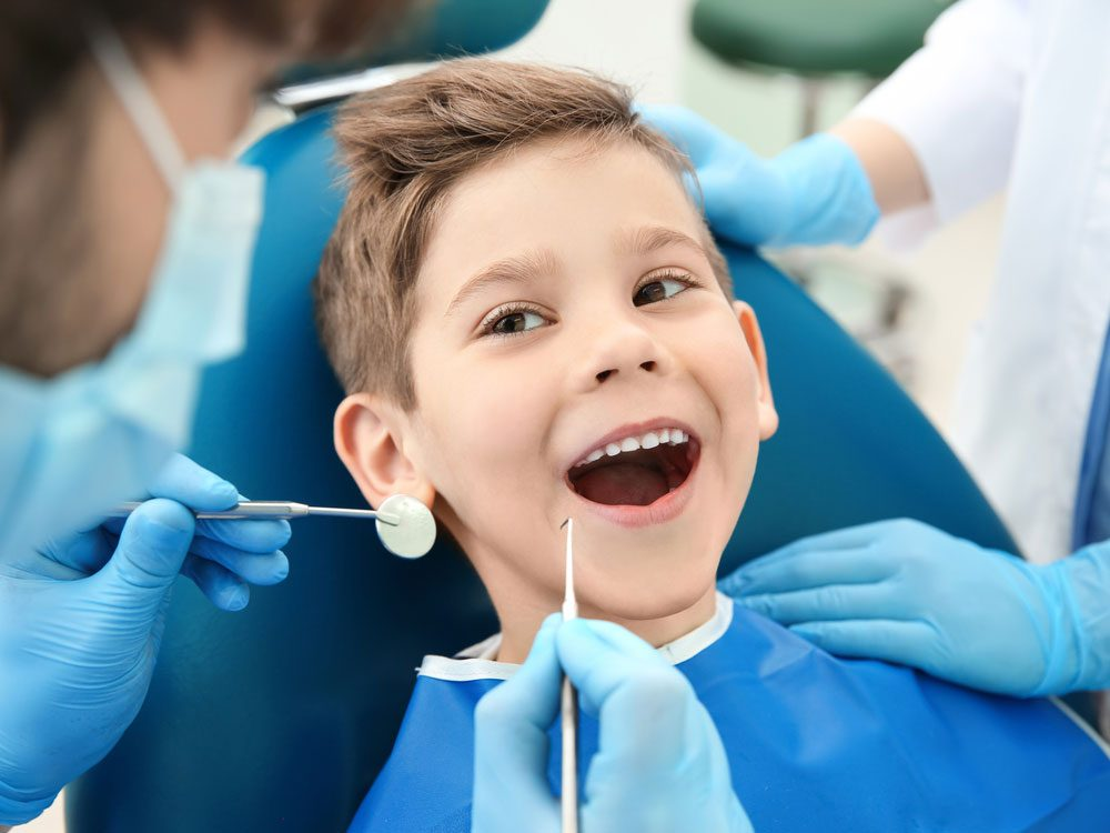 Smiling boy in dental chair