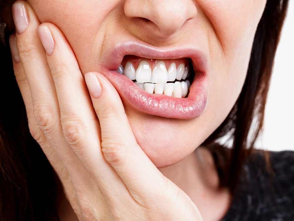 Woman experiencing extreme toothache