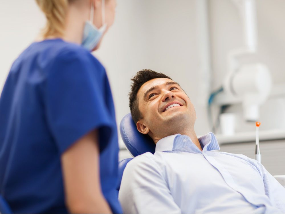 Man smiling at dentist's office