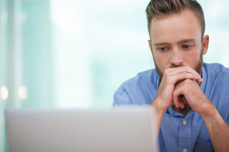 Bearded man on laptop