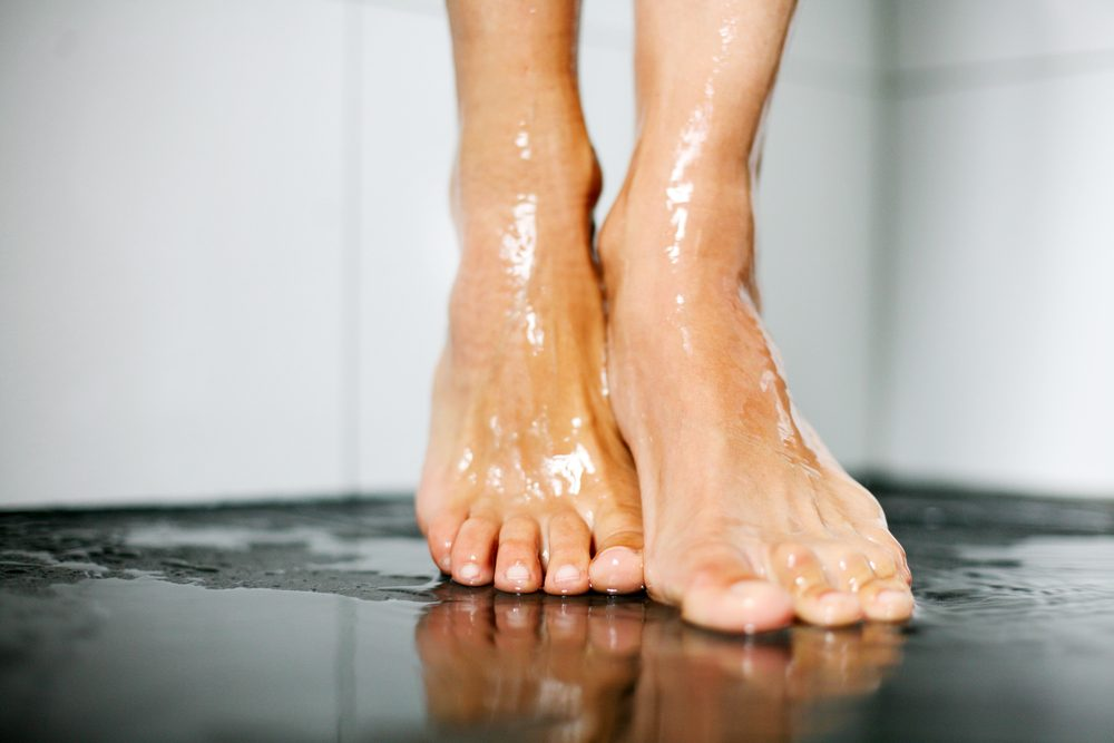 Female feet in shower