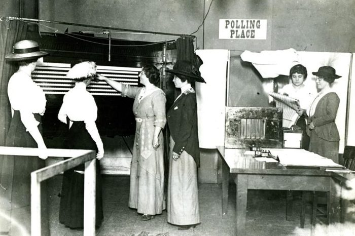 Chicago, Around 1915 -- The Earliest Beginnings Of Women's Participation In Government. Five Women Learning How To Use A Voting Machine In Chicago