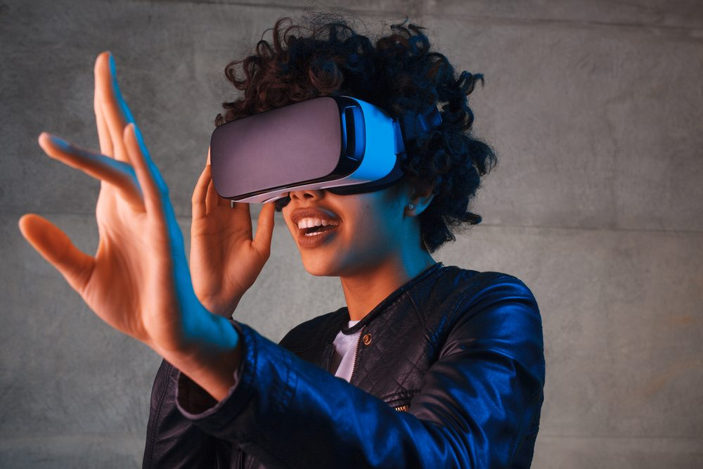 Attractive woman wearing virtual reality helmet