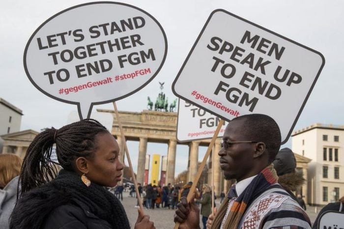 Participants of the rally against female genital mutilation hold placards at the Brandenburg Gate in Berlin, Germany, 23 November 2017. A group of activists 'TERRE DES FEMMES' organized the event ahead of the International Day for the Elimination of Violence against Women on 25 November which was designated by the United Nations.