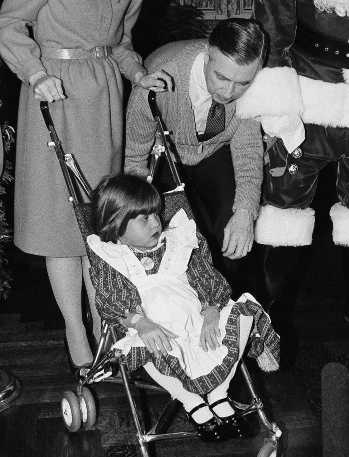 Mr. Rogers with toddler in stroller