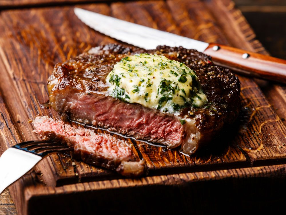 Medium rare steak with chive butter