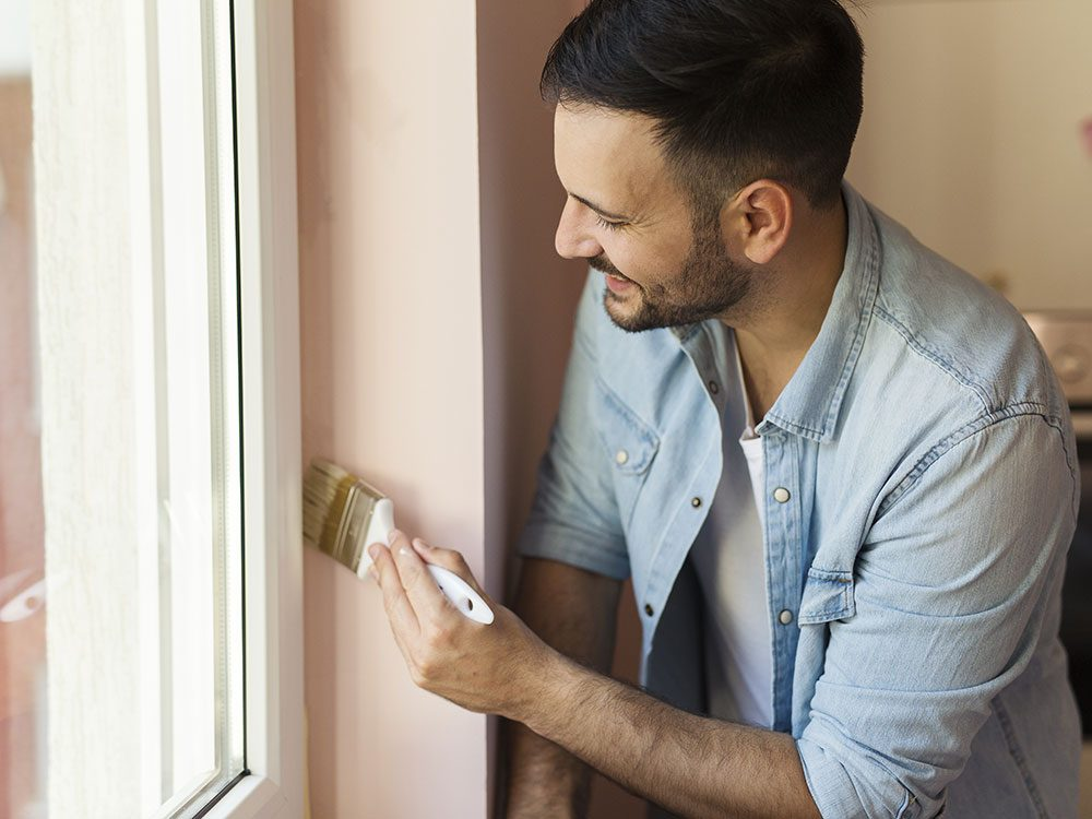Use nail polish remover to take paint off of windows