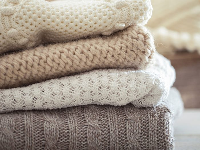 Use pillowcases to store sweaters