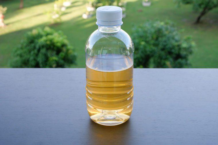 Yellow water in plastic bottle