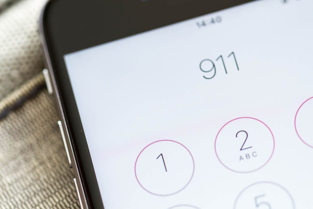 Emergency and urgency, dialing 911 on smartphone screen. Shallow depth of field.