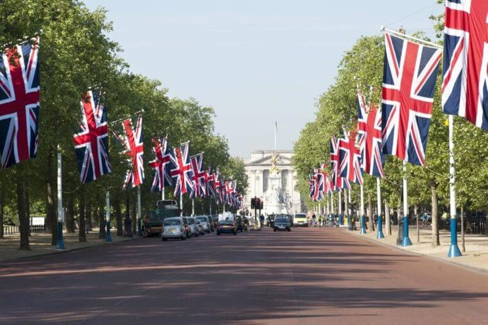 Union Jack flags lining the Mall towards Buckingham Palace for state occasion, London, England, Britain