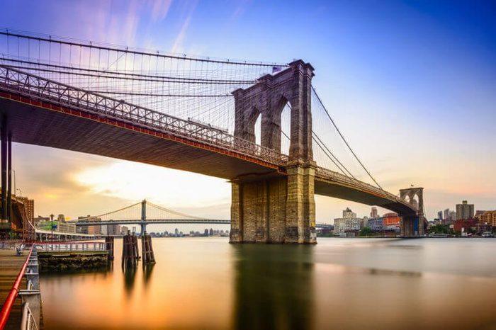 Brooklyn Bridge in New York City at dawn.