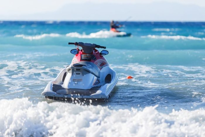 Blue sea and a jet ski floating on sea,