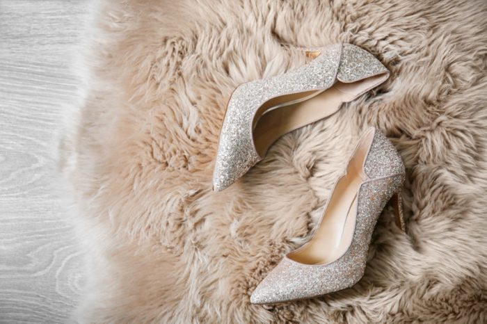 Beautiful high heeled shoes on furry rug