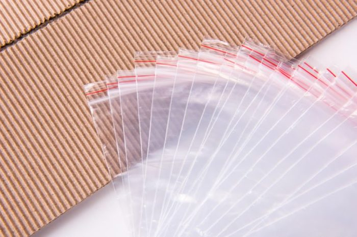 Sealing plastic bag and paperboard.