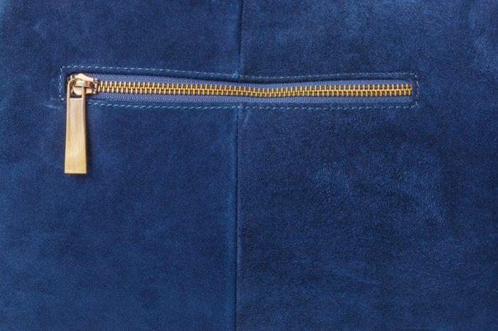 Pocket on blue handbag - fashion background