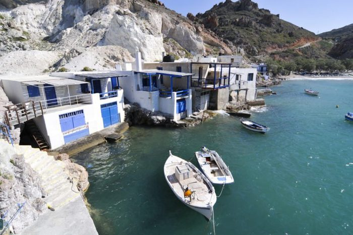 Small fishing huts, boats in front, Milos Island, Cyclades, Greece, Europe