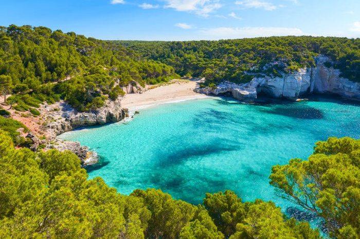 View of Mitjaneta beach with beautiful turquoise sea water, Menorca island, Spain