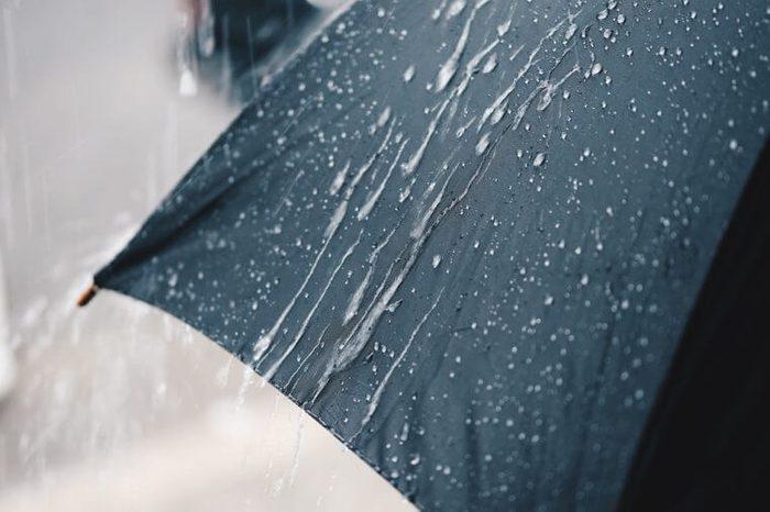 Back Umbrella in the rain in vintage tone