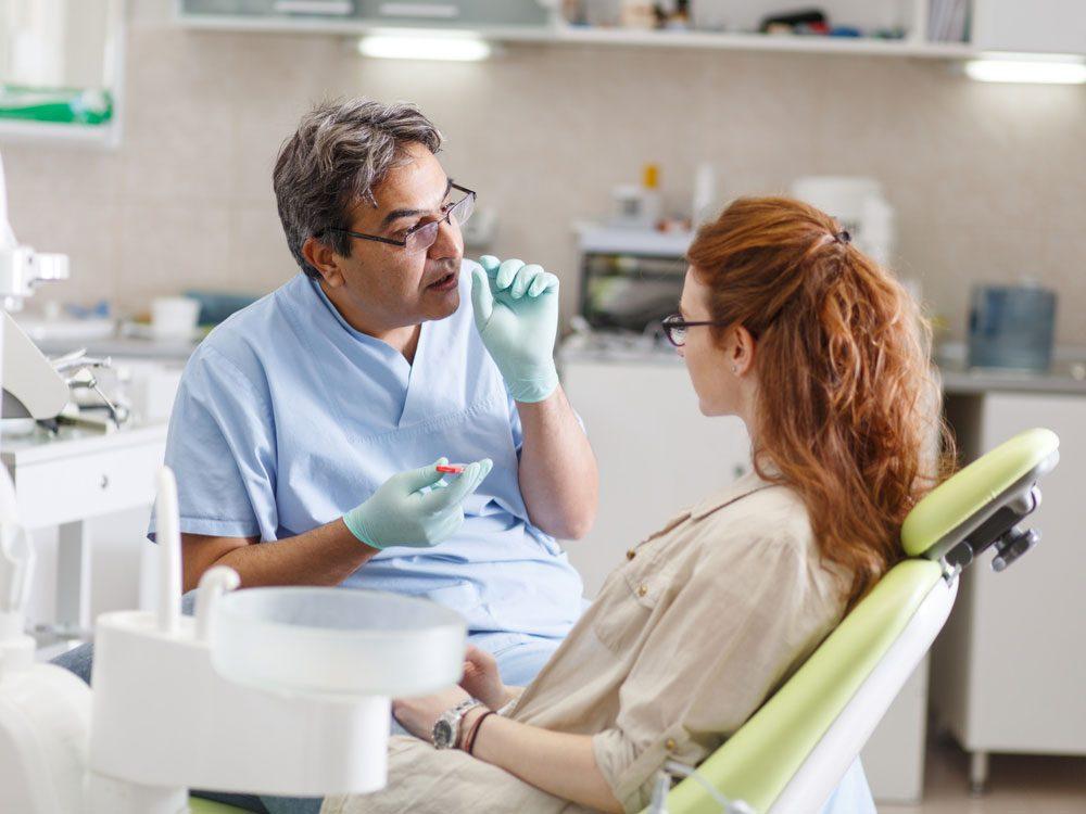 Dentist speaking to his patient