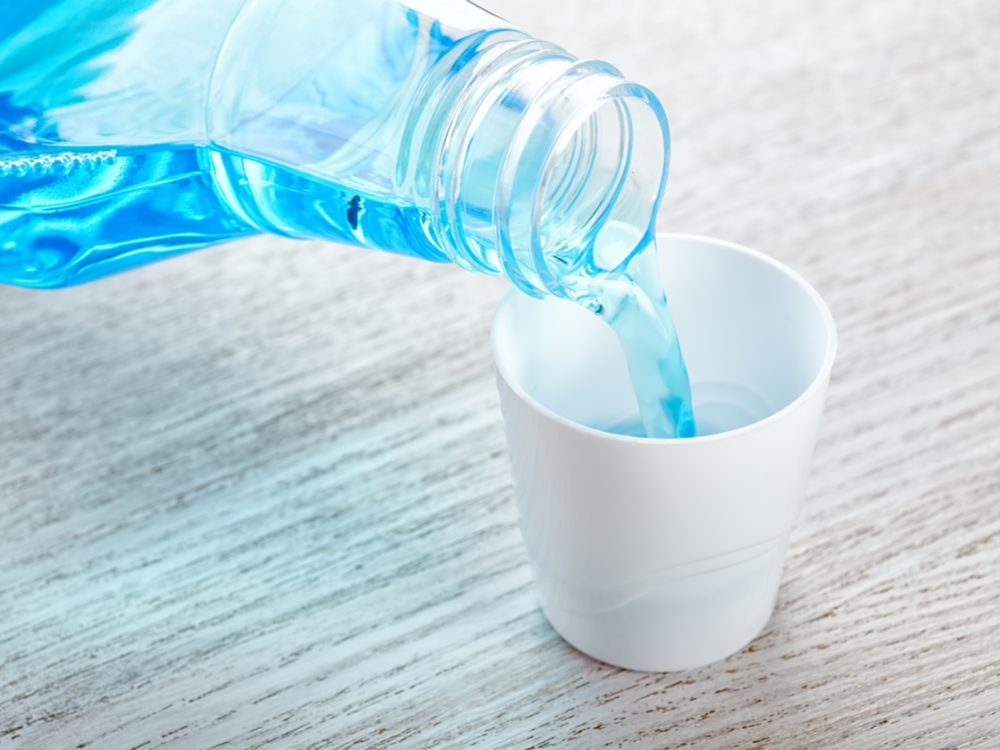 Pouring mouthwash into cup