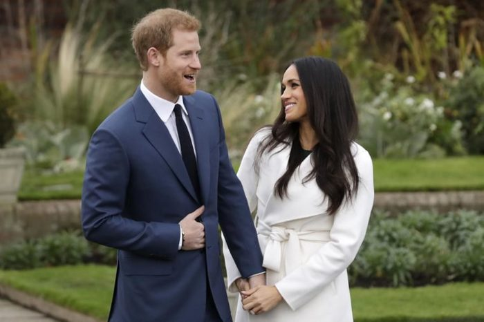 Dated, Britain's Prince Harry and his fiancee Meghan Markle pose for photographers in the grounds of Kensington Palace in London, following the announcement of their engagement. Speculation is mounting over who will be invited to the May 19, 2018, royal wedding of Prince Harry and Meghan Markle, with pundits guessing about the wedding guest list