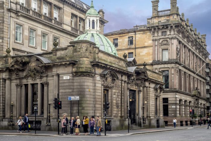 GLASGOW, SCOTLAND - JULY 21: Beautiful victorian architecture on Ingram Street on July 21, 2017 in Glasgow, Scotland. Glasgow is known for its Victorian architecture from the 19th century.