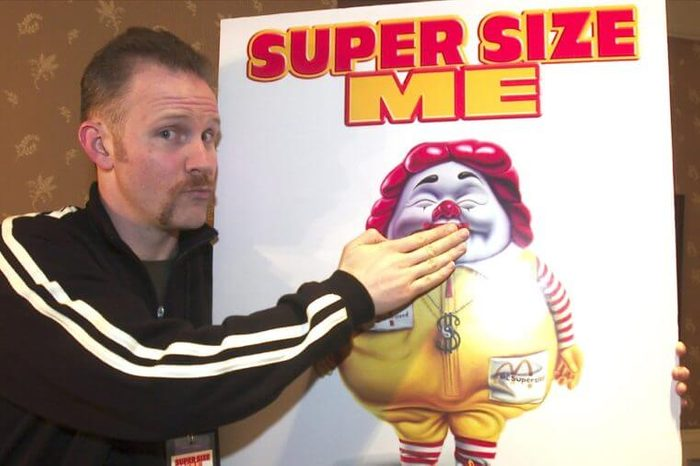 """MORGAN SPURLOCK Morgan Spurlock, director, producer and star of the documentary film """"Super Size Me"""" clowns with a movie poster at the U S Comedy Arts Festival, in Aspen, Colo. The documentary, which chronicles the deterioration of Spurlock's health during a monthlong experiment eating nothing but McDonald's food, won a directing prize at the Sundance Film Festival and is set for wide release this spring. McDonalds announced Wednesday that it will Supersize fries and drinks in its more than 13,000 U.S. restaurants and will stop selling them altogether by year's end, except in promotions"""