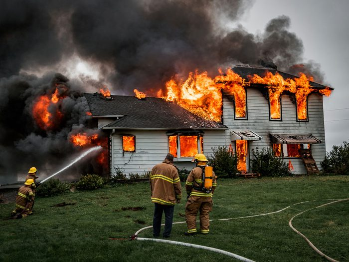 Firefighters extinguishing massive house fire