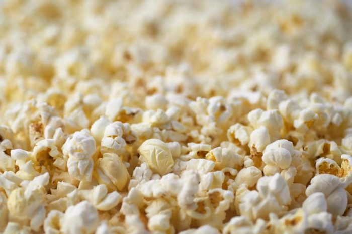 Popcorn Texture Background. Salted Popcorn Grains. Text Space