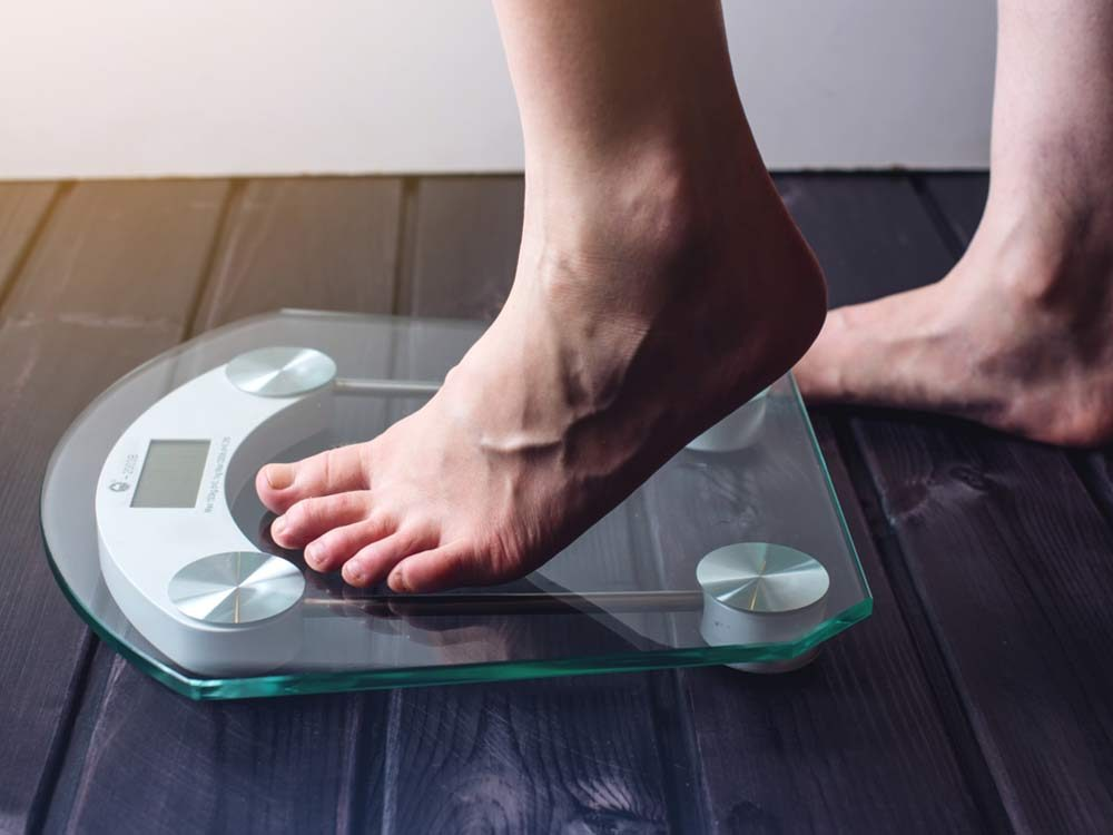 Close-up of feet on a weight scale
