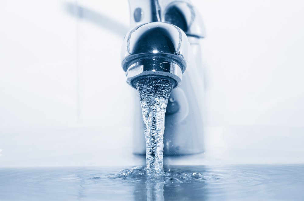 Faucet with flowing water closeup