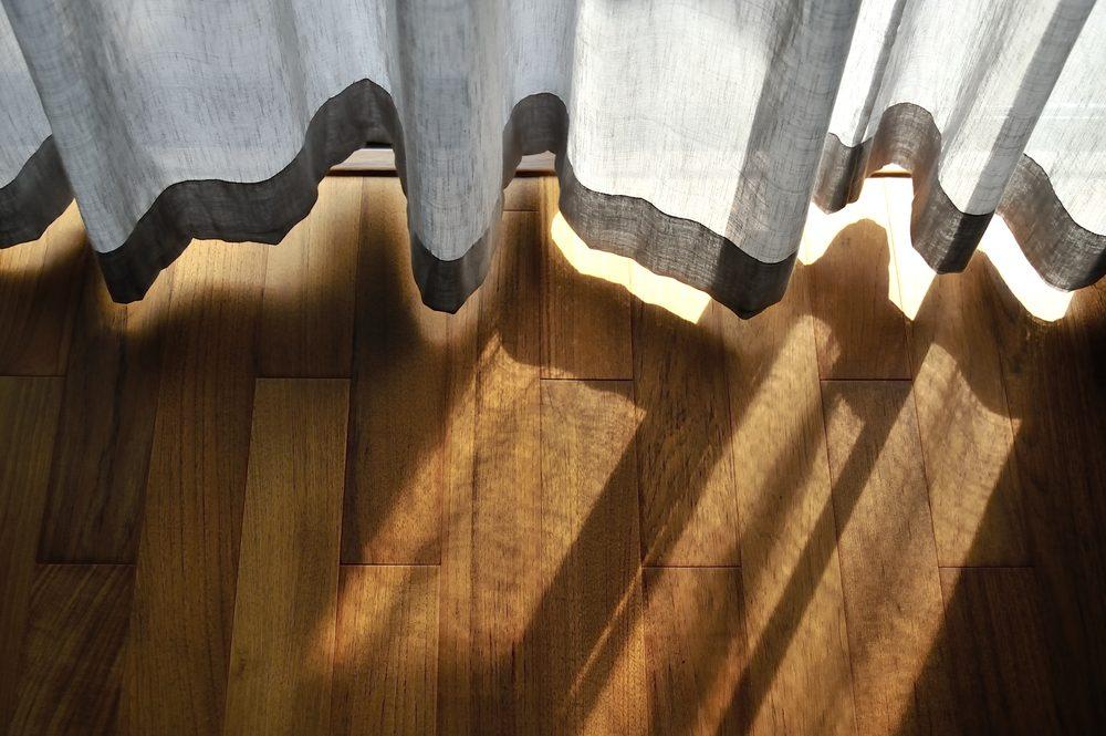 Light shining through curtains