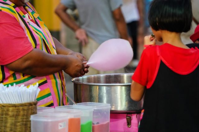Clown make cotton candy from sugar , candy floss